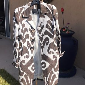 Brown and white colored coat